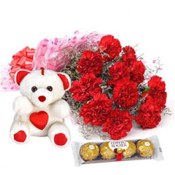 Exotic Ferrero Rocher with Teddy N Assorted Carnations Bouquet