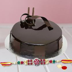 Delectable Rakhi Wishes Chocolate Cake with Rakhi, Roli Tika and Chawal for your Dear Brother
