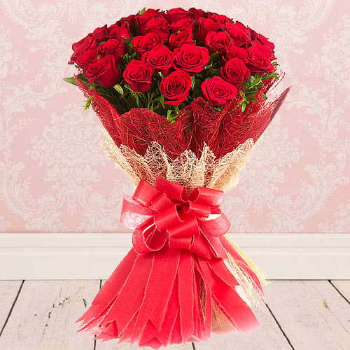 Captivating Hand Bunch of Red Roses