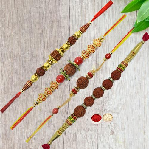 Beautifying Display of Four Pious Rudraksha Rakhi with Free Roli Tika and Chawal for your Dear Ones