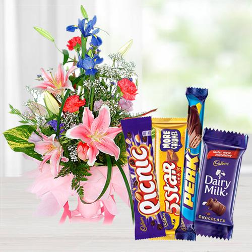 Stunning Assorted Flowers Arrangement with Mixed Cadbury Chocolate