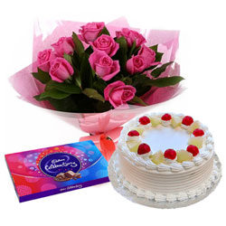 Tasty Cadbury Celebration with Cake and Pink Rose Bouquet