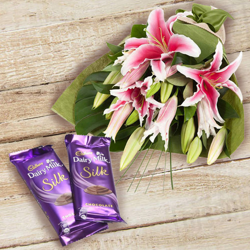 Impressive Pink Lilies Bouquet and Dairy Milk Silk