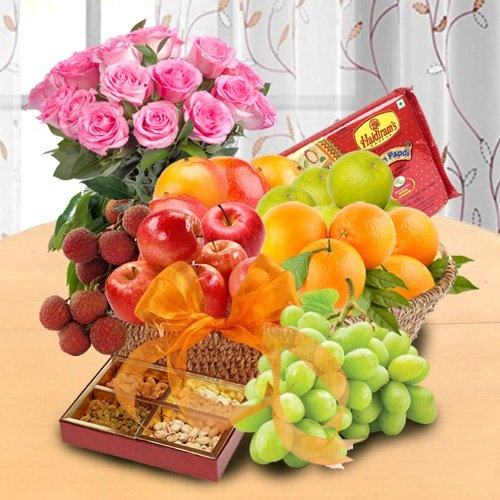 Basketfull of Fresh Fruits Basket & Soan papdi decorated with Pink Rose Bouquet for your Mummy