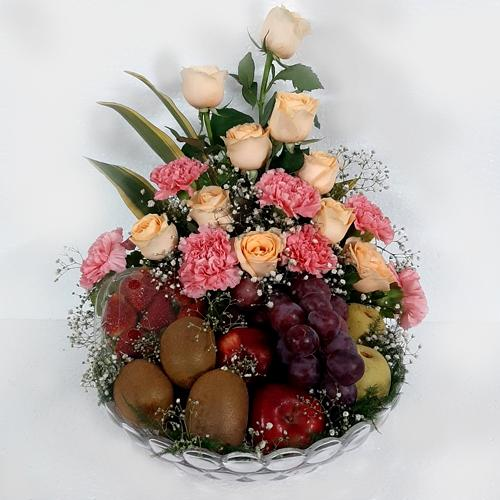 Exquisite Gift of Exotic Fruits N Flowers in Glass Vase