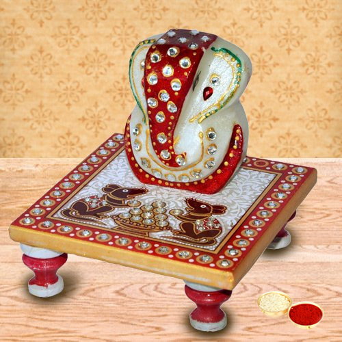 Delicately carved marbel designer ganesh with chowki with free Roli Tilak and Chawal