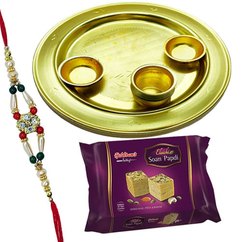 Delightful Selection of Soan Papri from Haldiram and Silver Plated Thali with free Rakhi, Roli Tilak and Chawal for Special Rakhi Festival